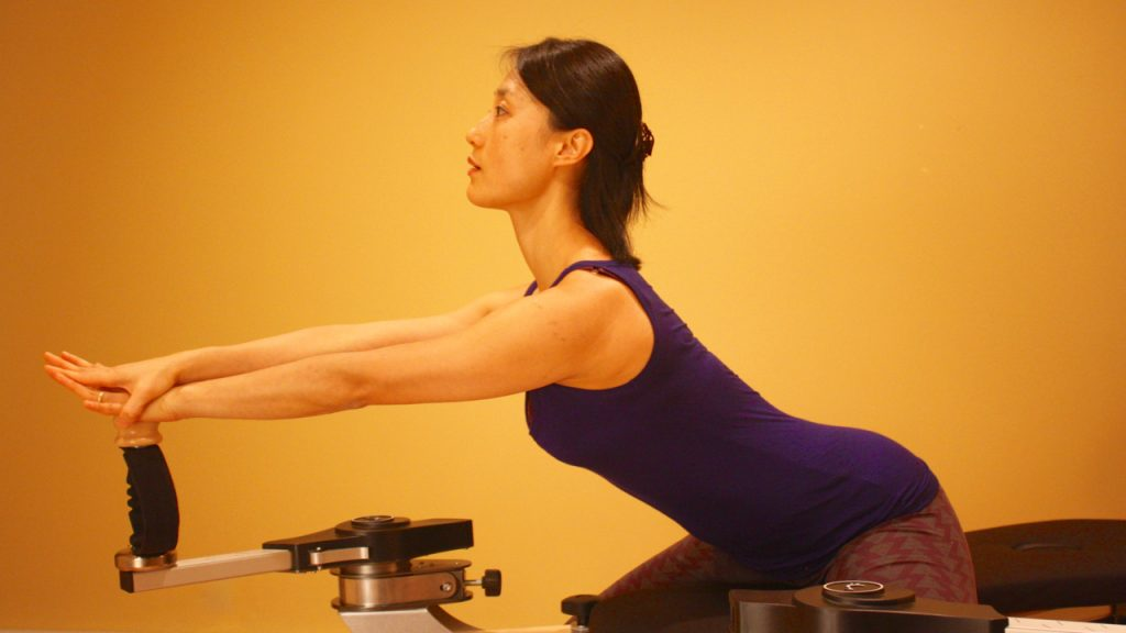 Fitness Trainer Kyung-sun  Baek demonstrates a Gyrotonic circular exercise movement.